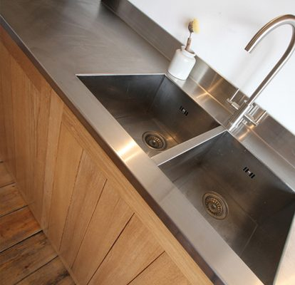 Reclaimed Teak cabinetry with stainless steel worktops