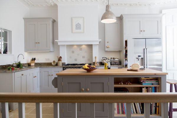 A  town house with shaker style kitchen, marble worktops and centre island with oak worktop.