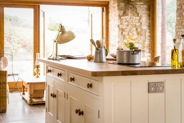 Detail view of oak island in traditional country kitchen with tongue and groove end panel