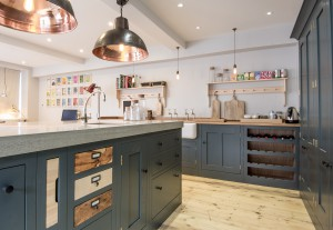 Kitchen island in shaker style industrial kitchen with concrete worktop