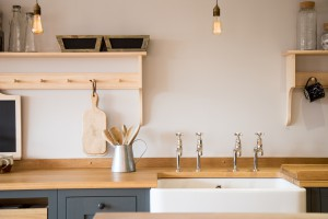 Belfast farmhouse sink set within shaker cabinets with oak worktop