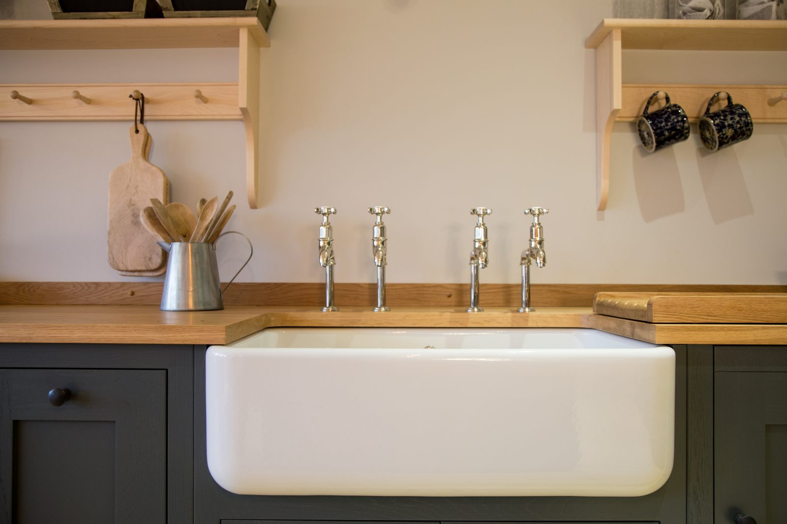 Belfast farmhouse sink with double Perrin & Rowe taps