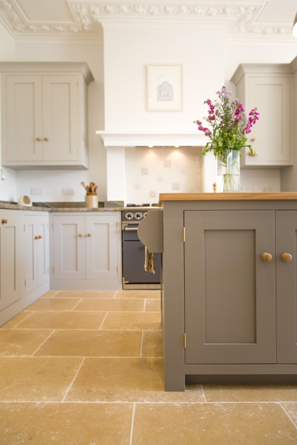 Shaker kitchen with natural stone flooring