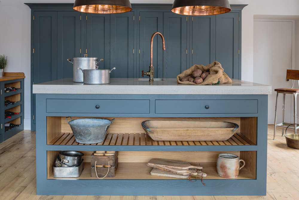 Island with concrete worktop in an industrial shaker kitchen