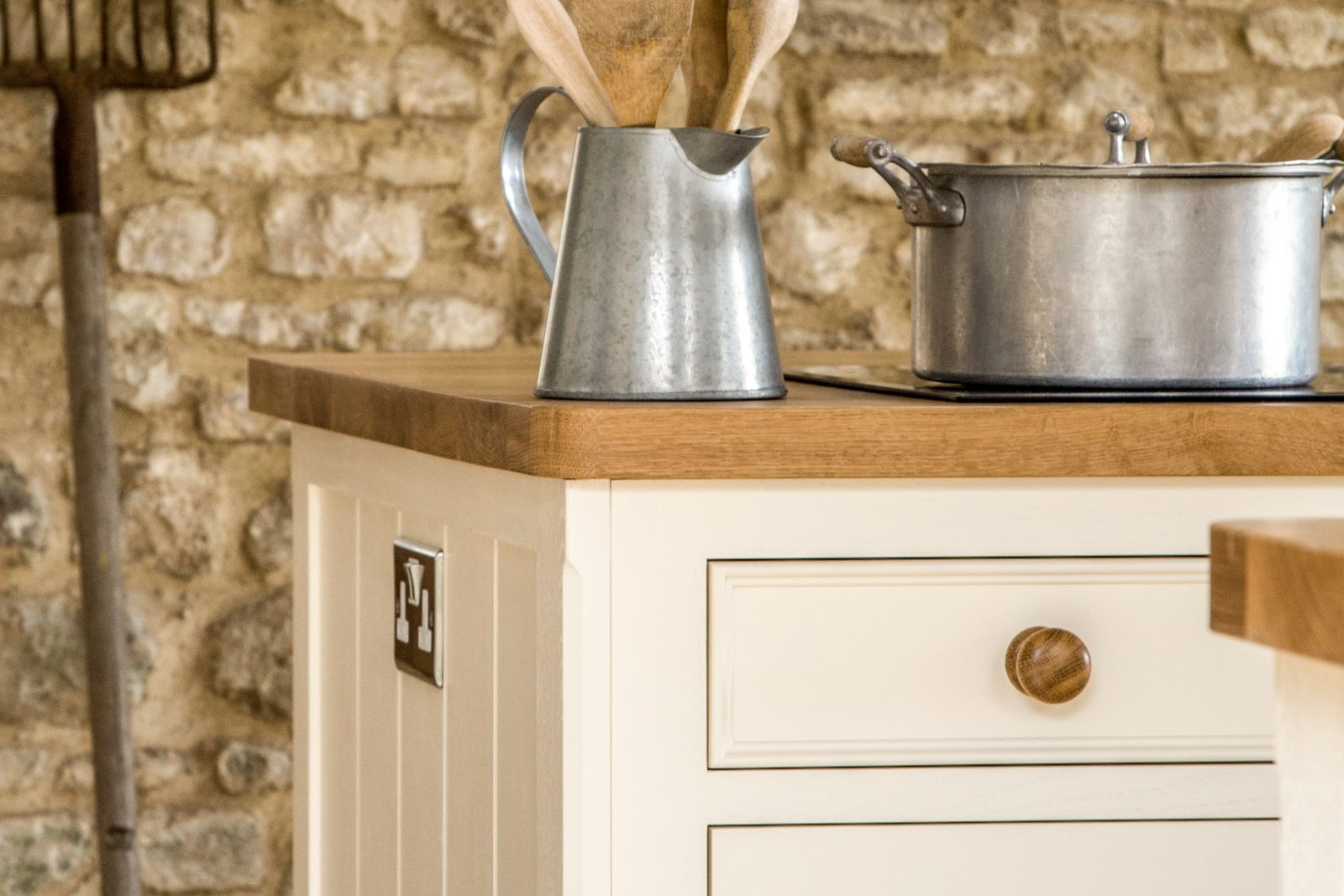 Detail of oak island in Farrow and Ball Tallow with tongue and groove end panel