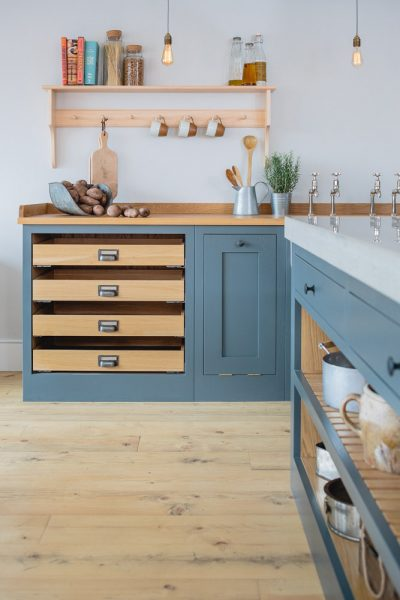 Industrial shaker kitchen with oak worktop and open drawers