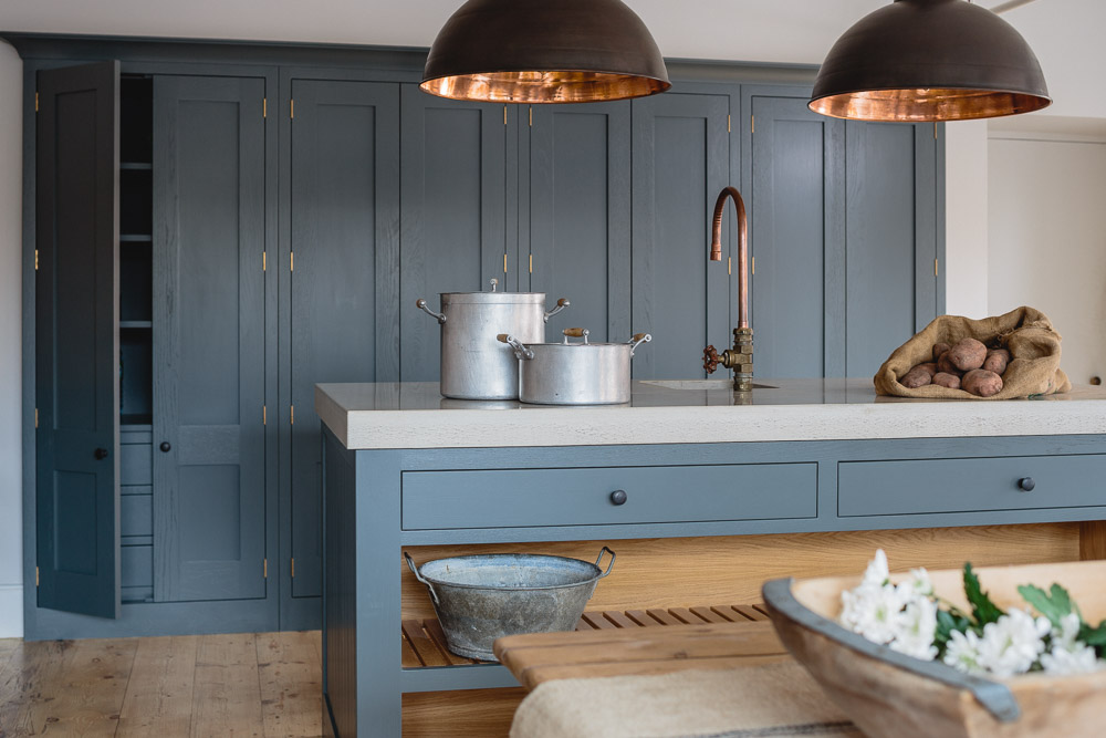 Island with concrete worktop in industrial shaker kitchen