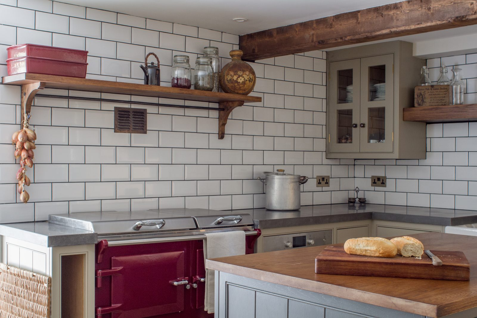 The cosy country cottage kitchen with traditional walls and authentic country cottage doors, with a shaker style kitchen with farmhouse sink and oak worktop.