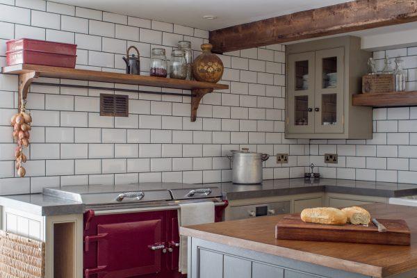 Oak shaker kitchen with white metro tiles, oak worktops and burgundy Everhot range cooker