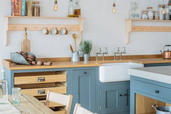 Sustainable kitchen industrial shaker showroom with oak and concrete worktop