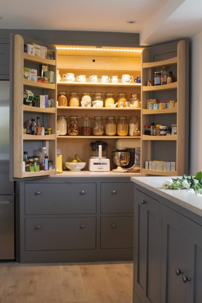 Oak shaker kitchen with open larder cupboard with internal LED lighting