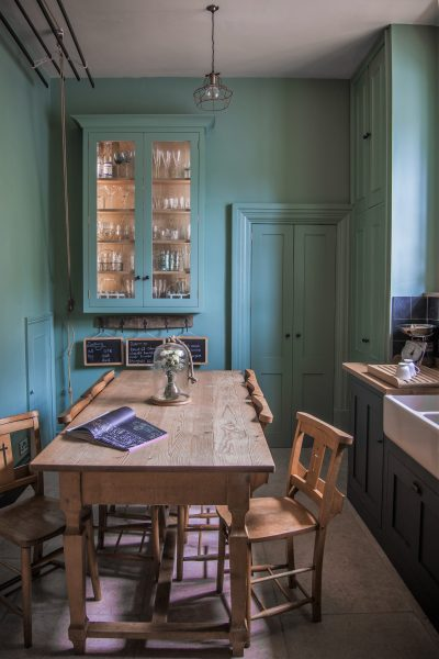 Shaker kitchen painted in Farrow & Ball Chappell Green with pine dining table