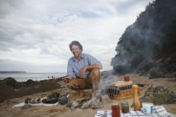 Jon Lewin on a beach