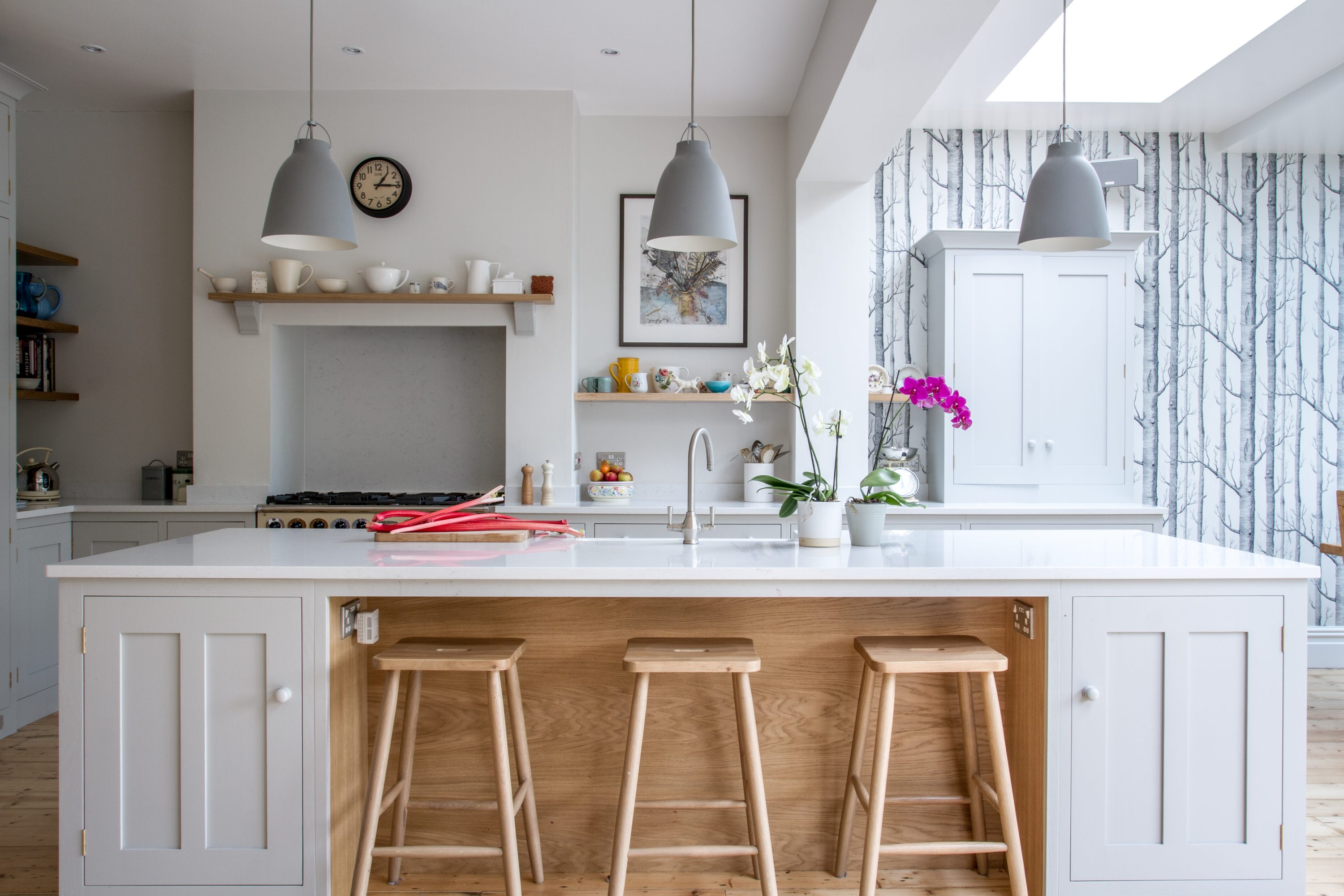 west london kitchen design. View of shaker style kitchen with island  pendant lights and floating shelves Sustainable Kitchens Installing in London