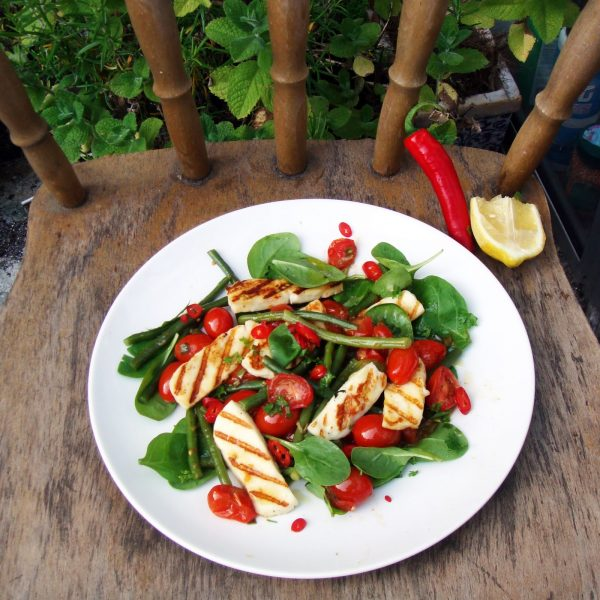 Warm tomato and French bean salad with fried halloumi.