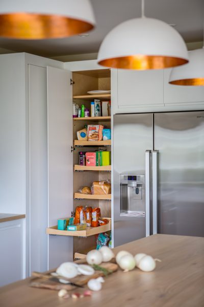 View of pull out shelves in larder cabinet