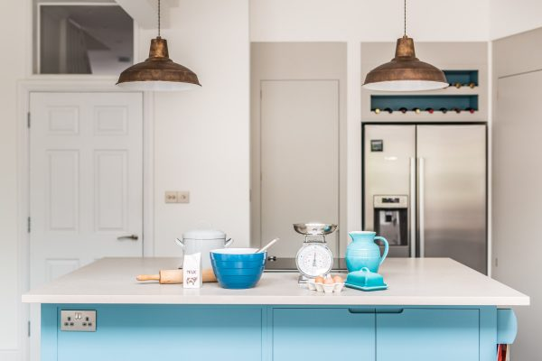Flat panel kitchen with large island painted in Farrow & Ball Stone Blue