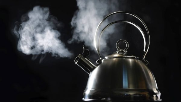 Metal kettle with steam coming out