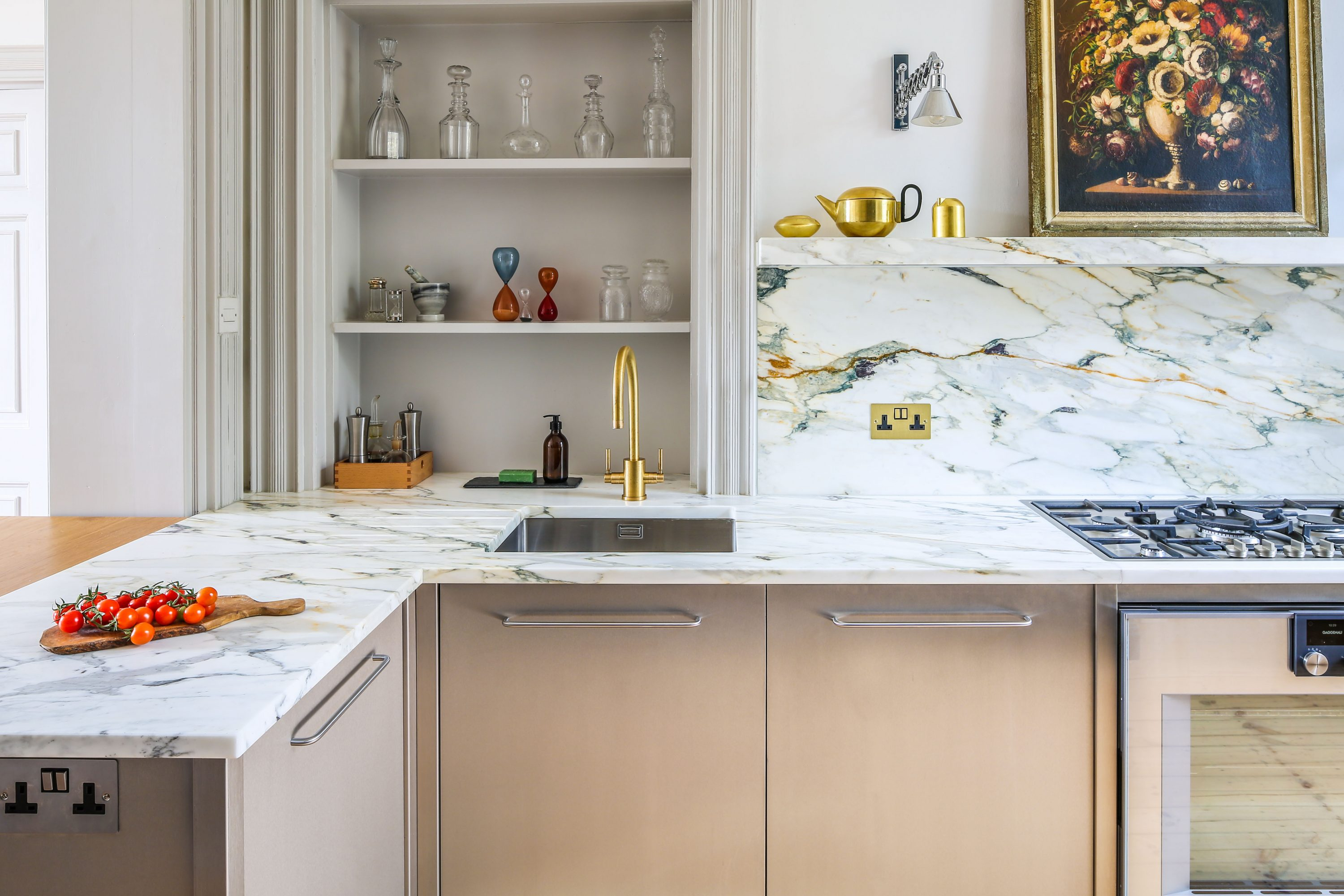 View of kitchen cabinet wrapped in Stainless Steel with a marble worktop