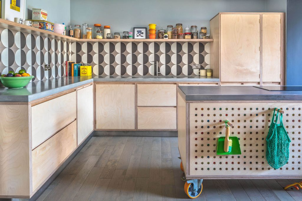 Pegboard Plywood Kitchen with concrete worktop