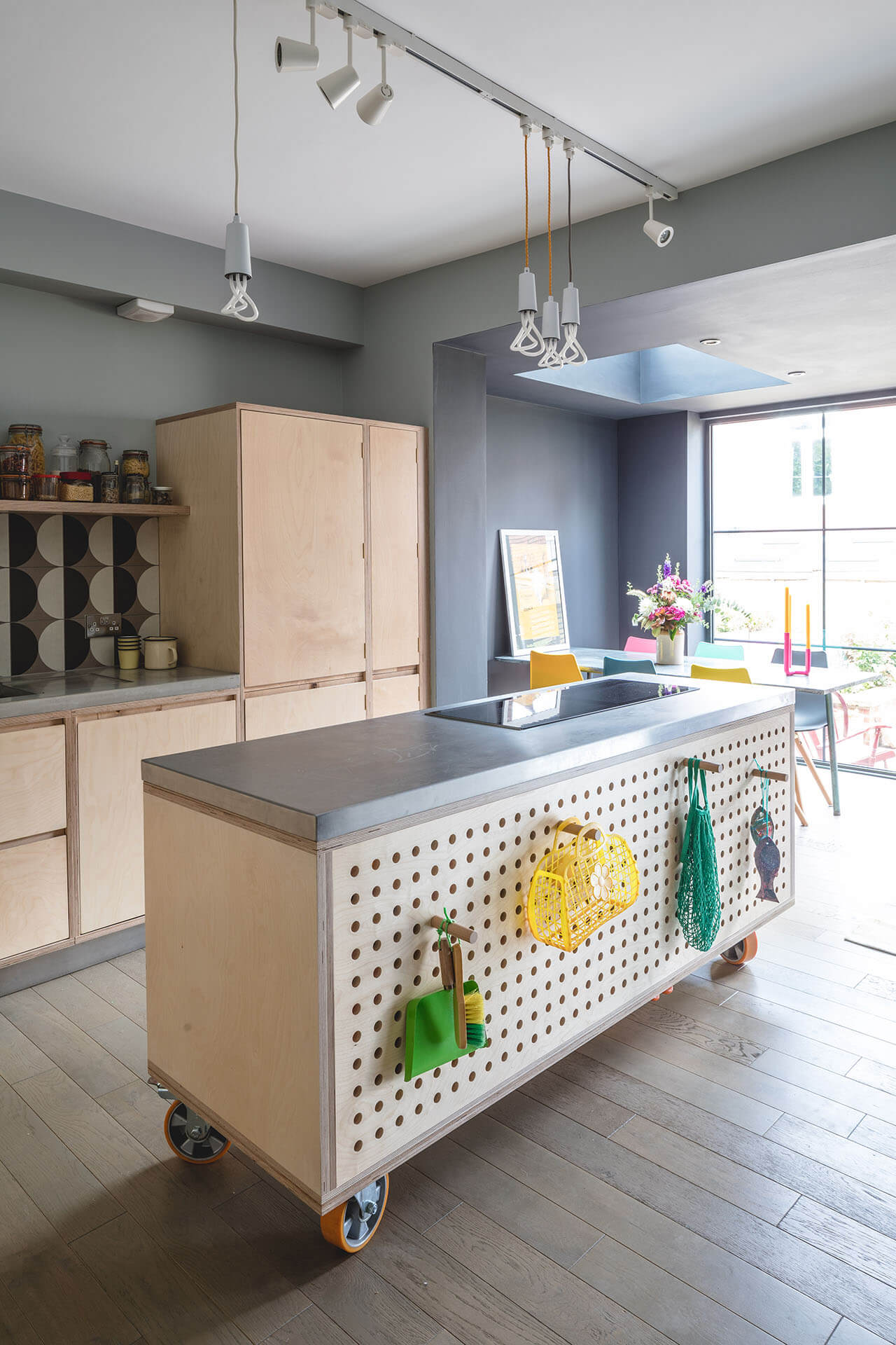Pegboard Plywood Kitchen with movable island and stainless steel worktop