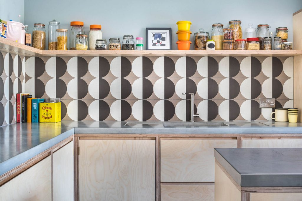 Pegboard Plywood Kitchen with porcelain tiles and floating shelf