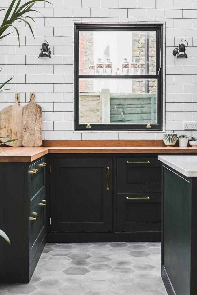 Dark Green Shaker kitchen handpainted in Obsidian Green (216) by Little Green , Fired Earth Metro wall tiles , iroko worktop and hexagonal concrete floor tiles