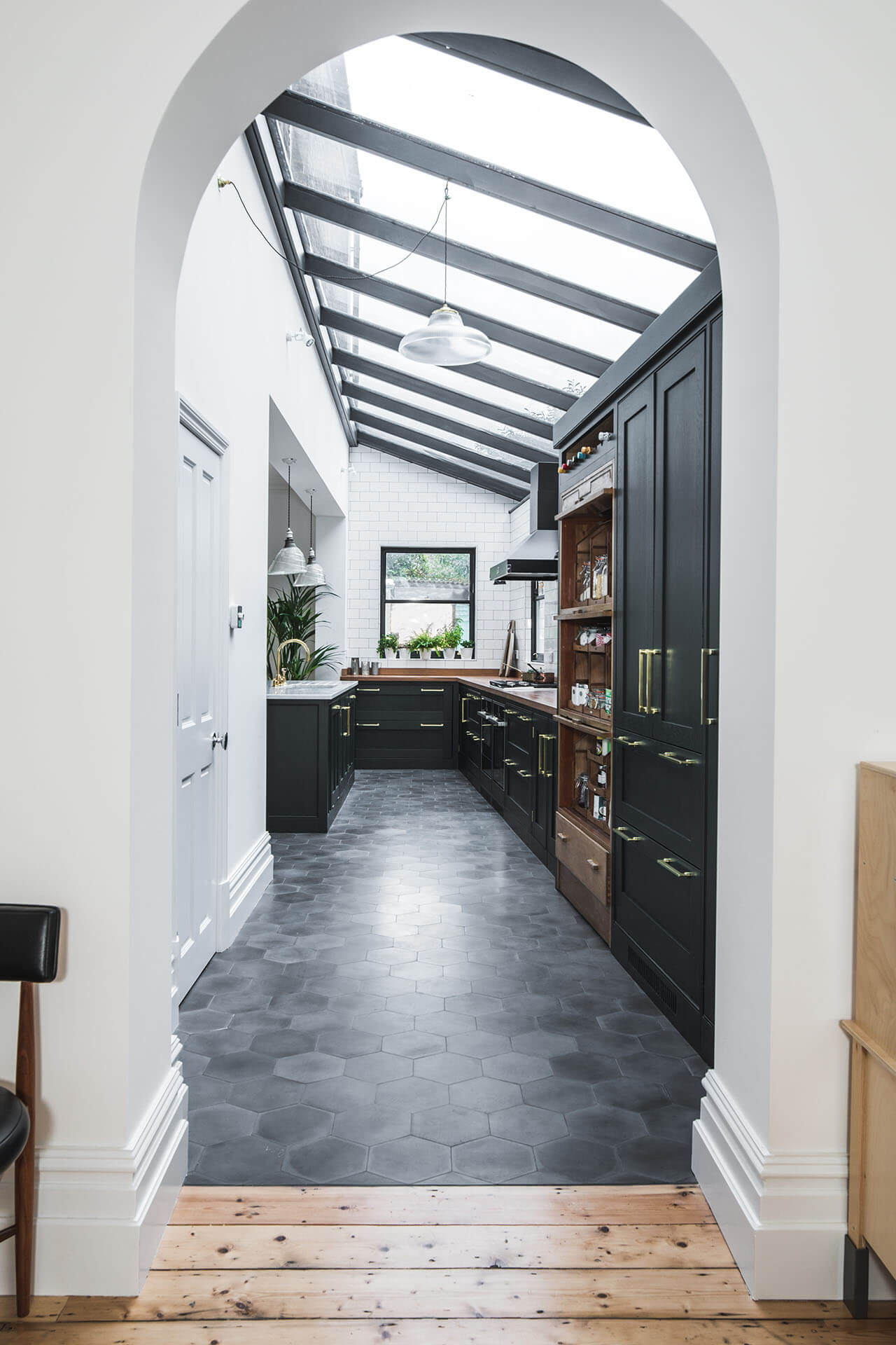 Dark Green Shaker kitchen in lean-to extension hand painted in Obsidian Green (216) by Little Green with hexagonal concrete tiles