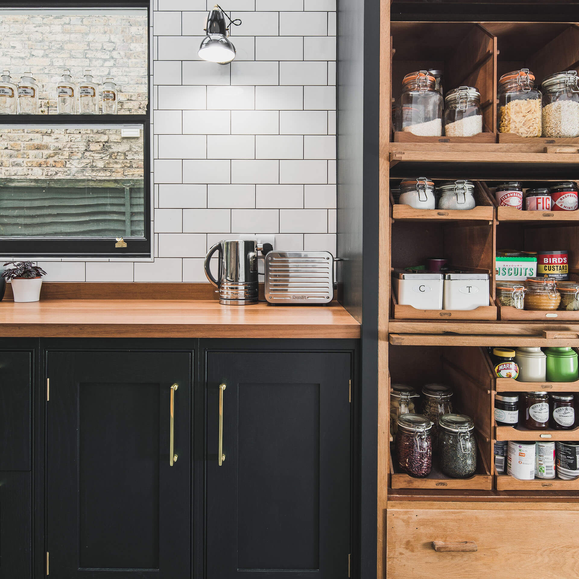 Dark Green Shaker kitchen with fully fitted reclaimed vintage haberdashery cabinet, cabinets are painted in Little Green Obsidian Green (216)