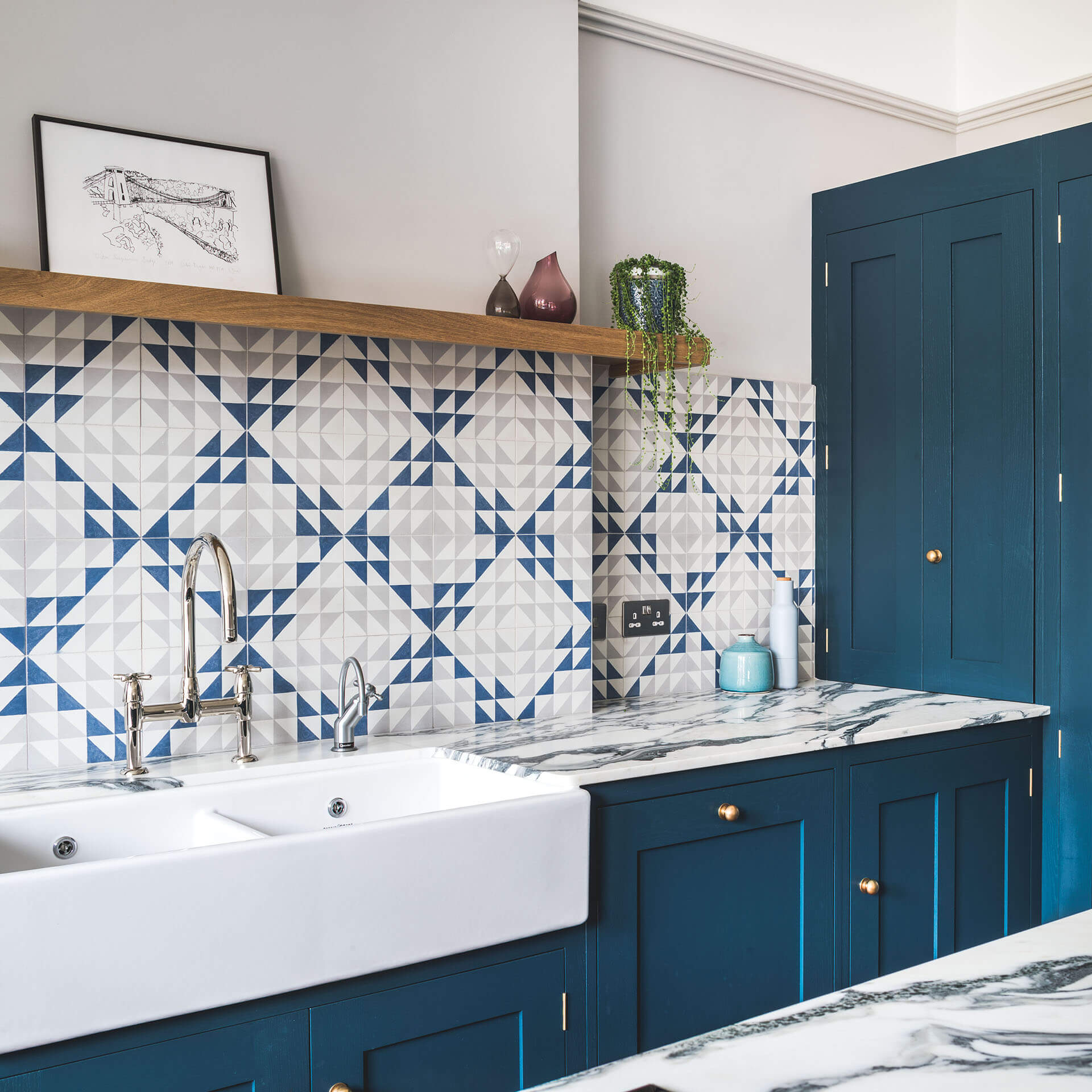 Dark blue geometric kitchen with Belfast sink and marble worktop