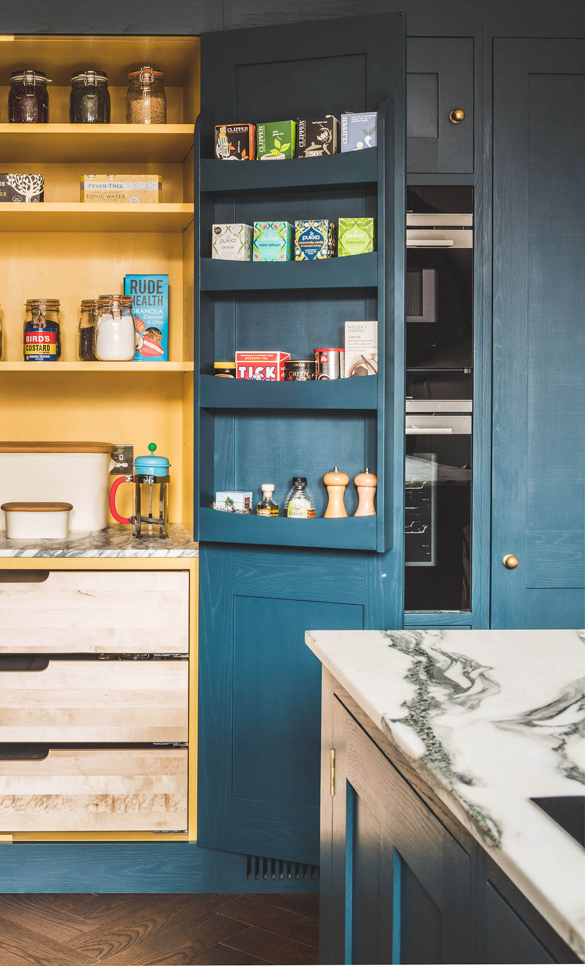 Dark blue geometric kitchen with painted food racks