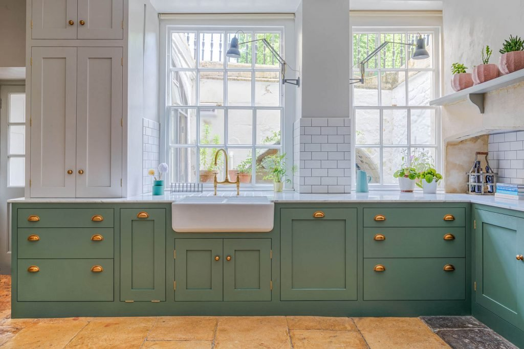 Green Shaker Kitchen with Brass Accents and double drawer cabinets with dovetail drawers