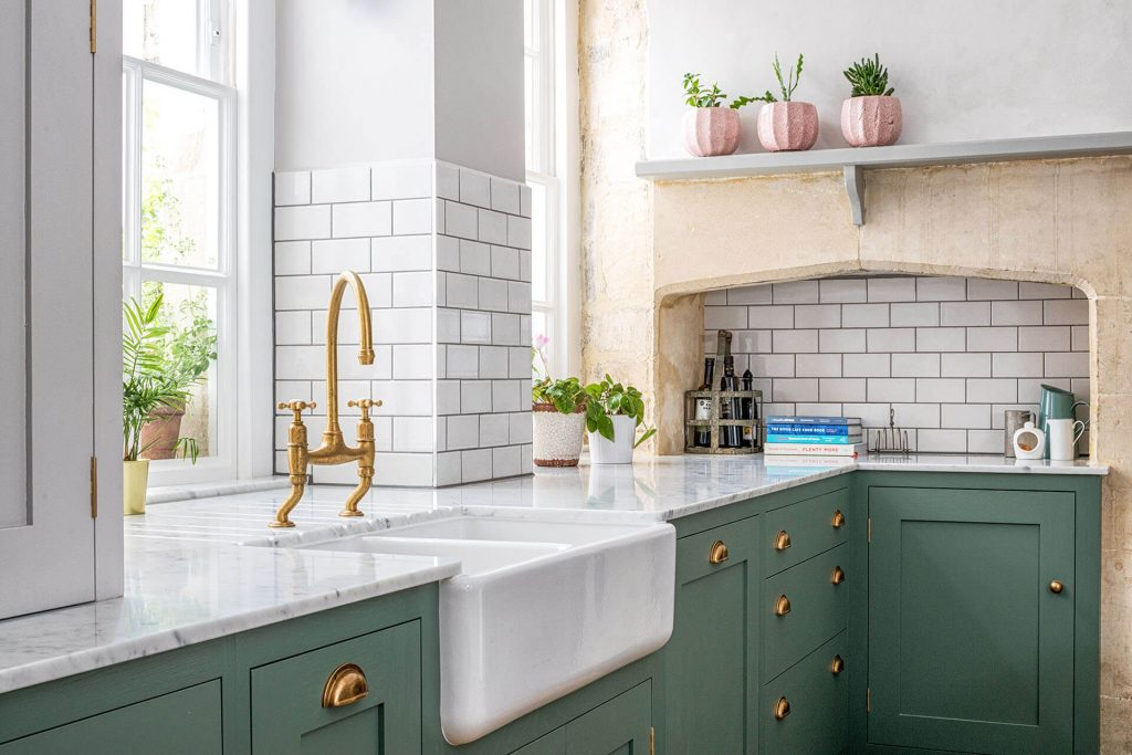 Green Shaker Kitchen with Perrin & Rowe Ionian with crosstops in Aged Brass