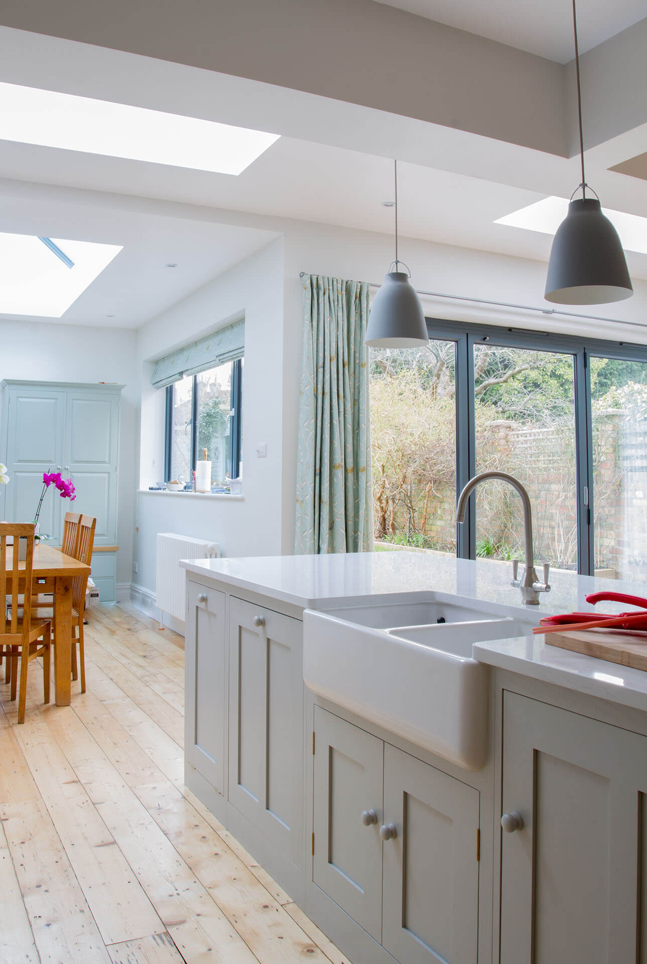 Scandinavian Woodland Kitchen with Farrow & Ball Pavilion Gray painted shaker cabinets