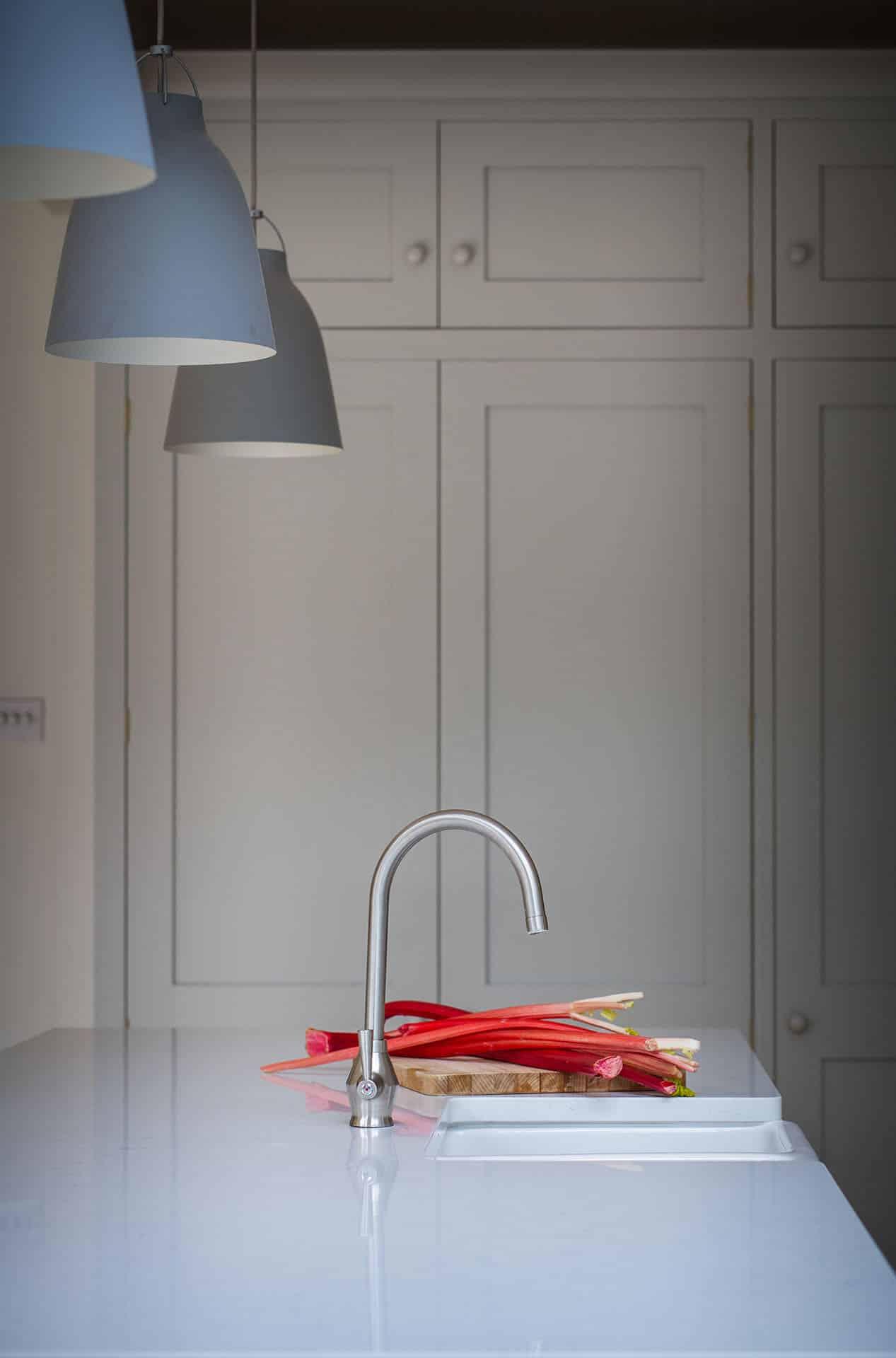 Scandinavian Woodland Kitchen with white quartz worktops and large kitchen centre island