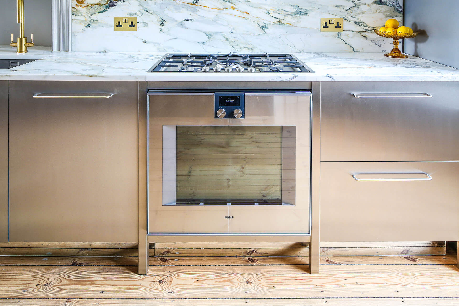 Steel, Marble Contemporary Kitchen with Gannenau oven and brass sockets