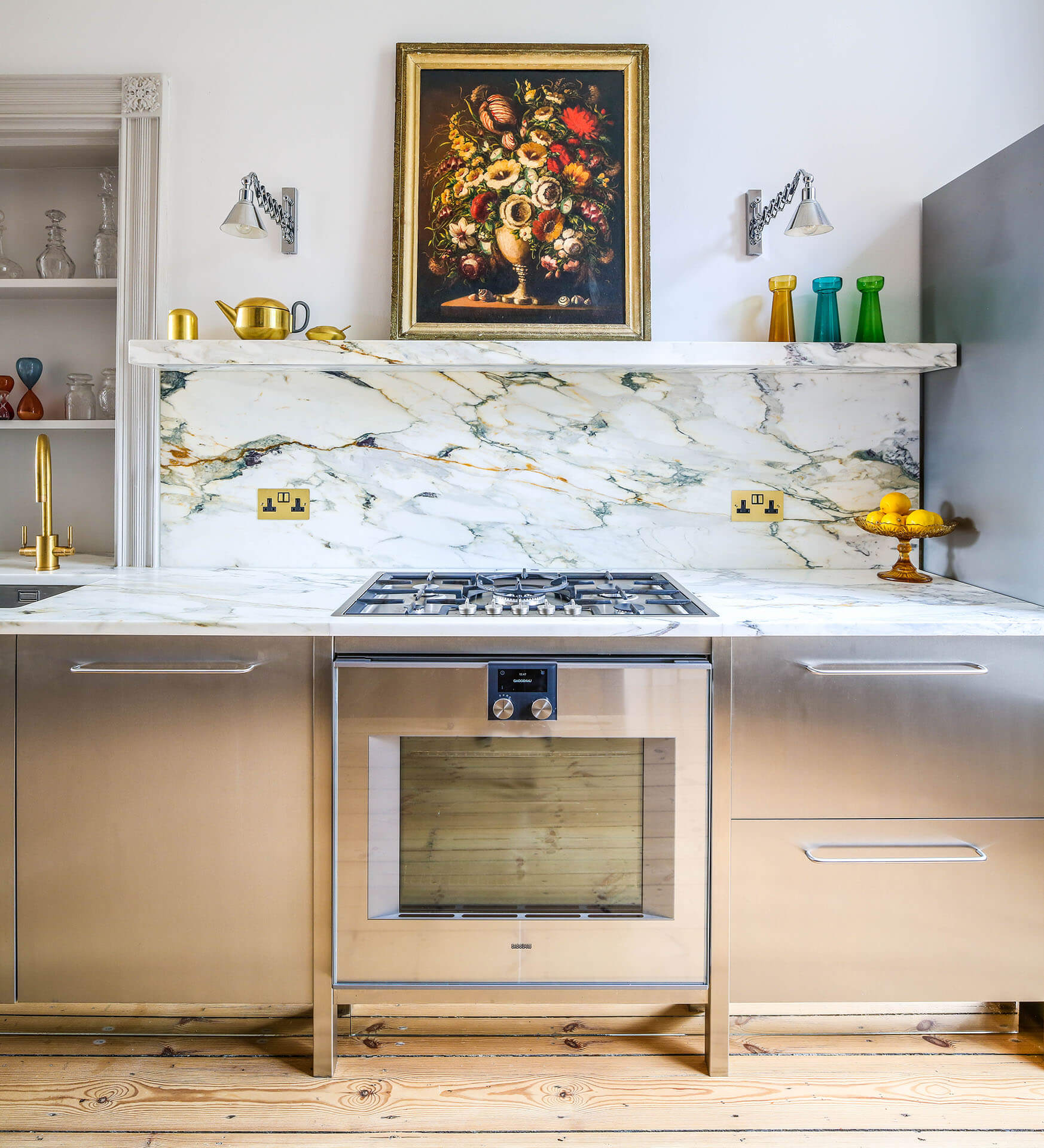 Steel, Marble Contemporary Kitchen with mable worktop, Gaggenau oven and pine floor