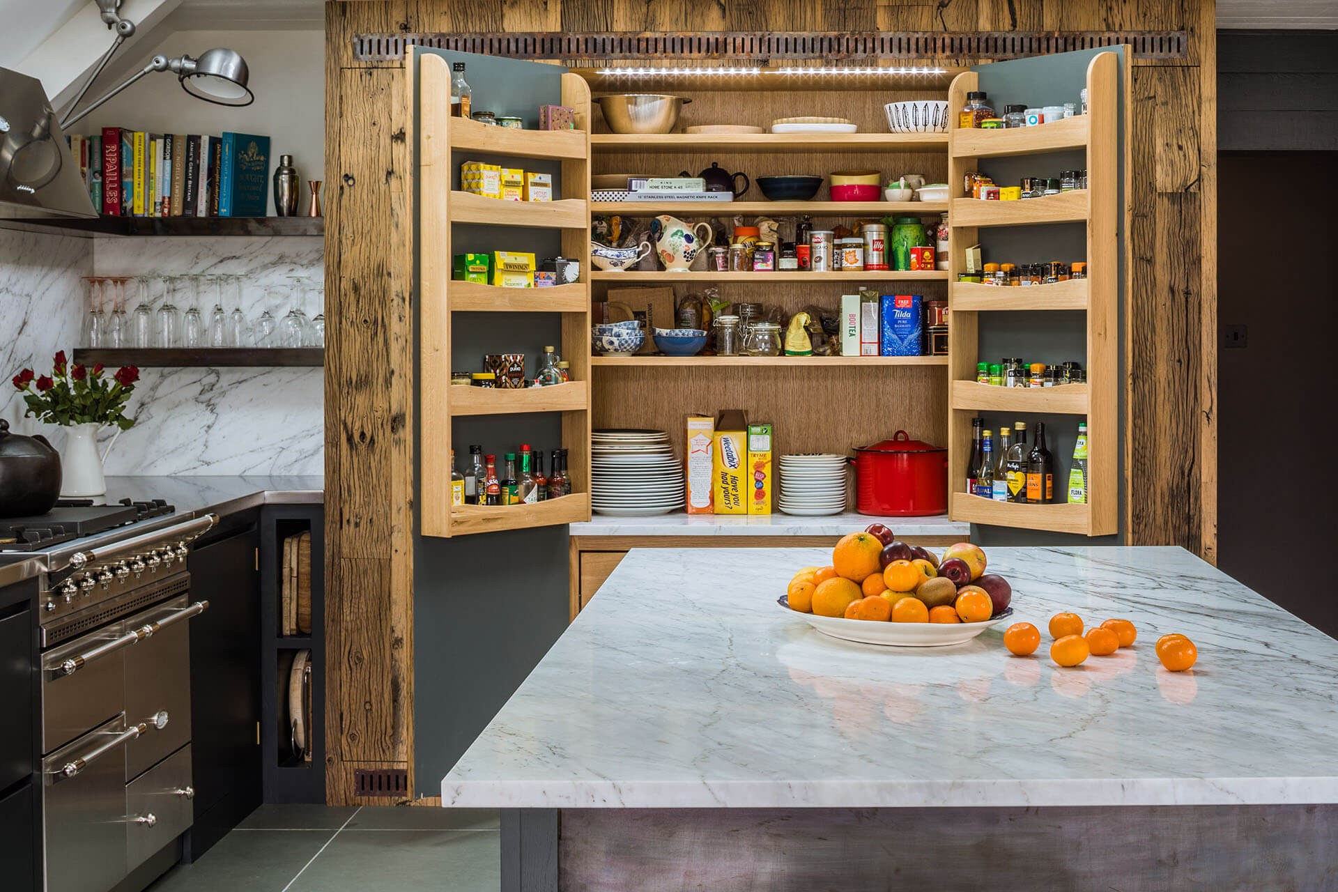 Steel, Marble, Reclaimed Wood Kitchen with extensive double larder with oak internals and oak spice racks and a marble cold shelf.