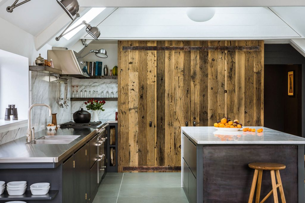 Steel, Marble, Reclaimed Wood Kitchen with full heigh integrated reclained oak kitchen furtinute, marble island and cabinetss painted in Farrow & Ball Railings No.31