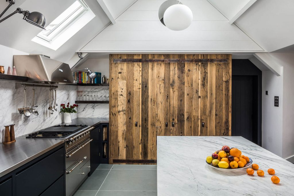 Steel, Marble, Reclaimed Wood Kitchen with stainless steel worktop, Calacatta Venato marble island worktop, Lacanche Hood & Range and reclaimed boxcar oak larder