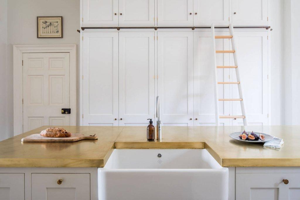 White Shaker Kitchen with Belfast sink, brass worktop and rolling ladder