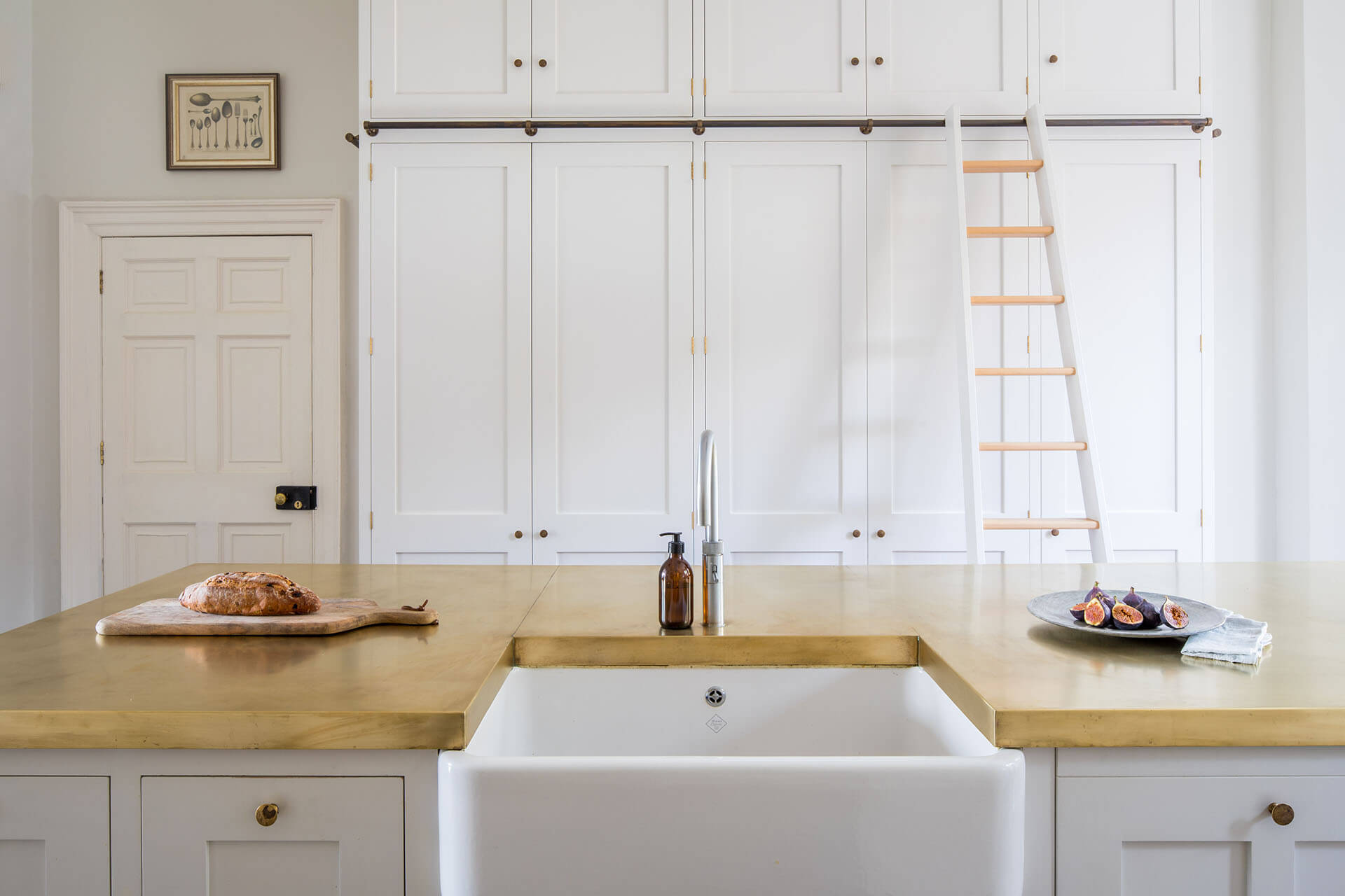 White Shaker Kitchen with Belfast sink, brass worktop and rolling ladder
