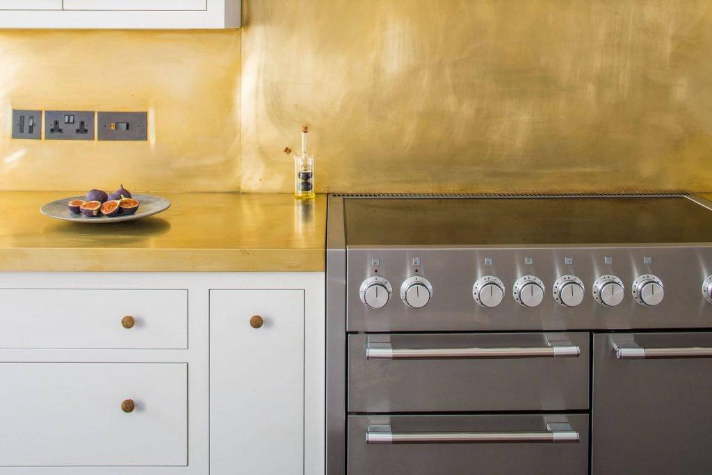 White Shaker Kitchen with Mercury range, induction top and brass splashback