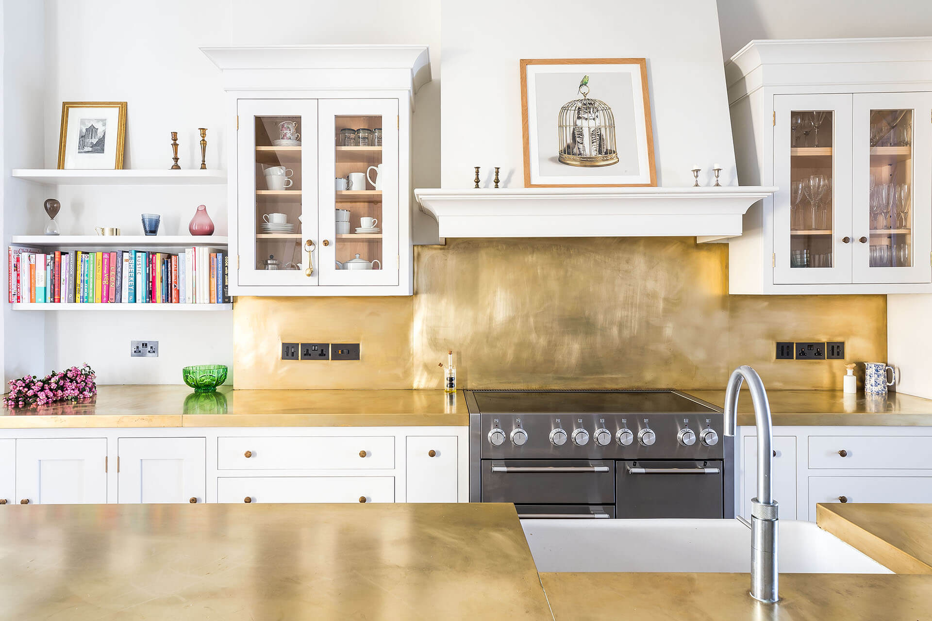 White Shaker Kitchen with brass centre island worktop and brass splashback