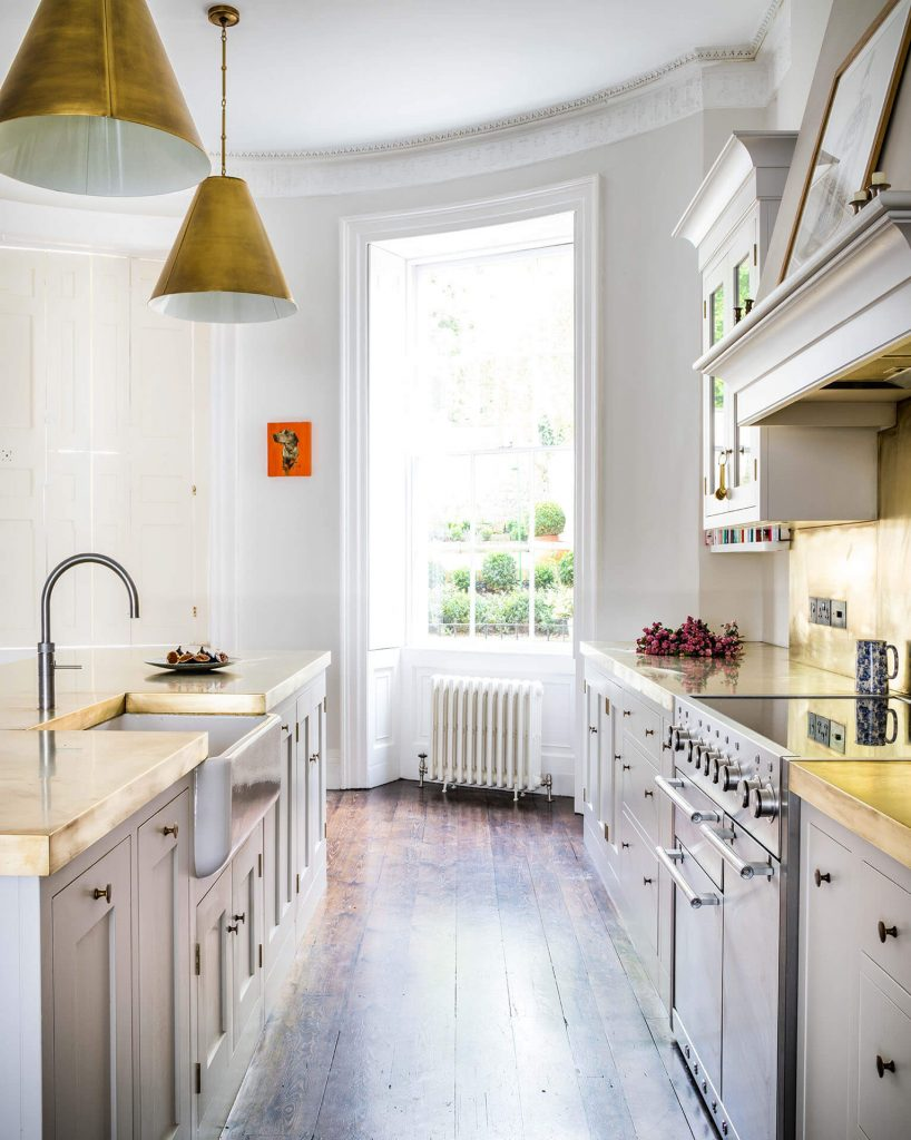White Shaker Kitchen with brass pendant lights and dark pine floor