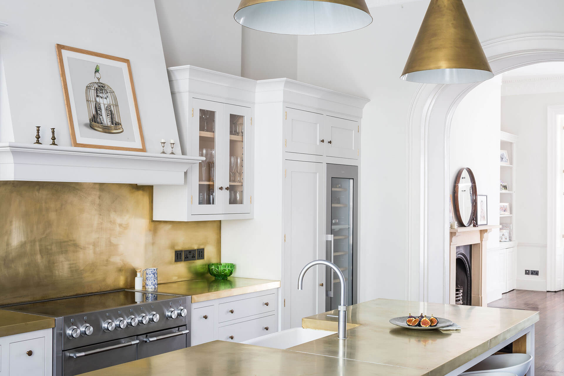 White Shaker Kitchen with brass worktops, brass splashback and brass pendant lights
