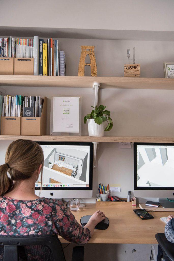 Charlie Draper at her desk in the showroom designing September 2018