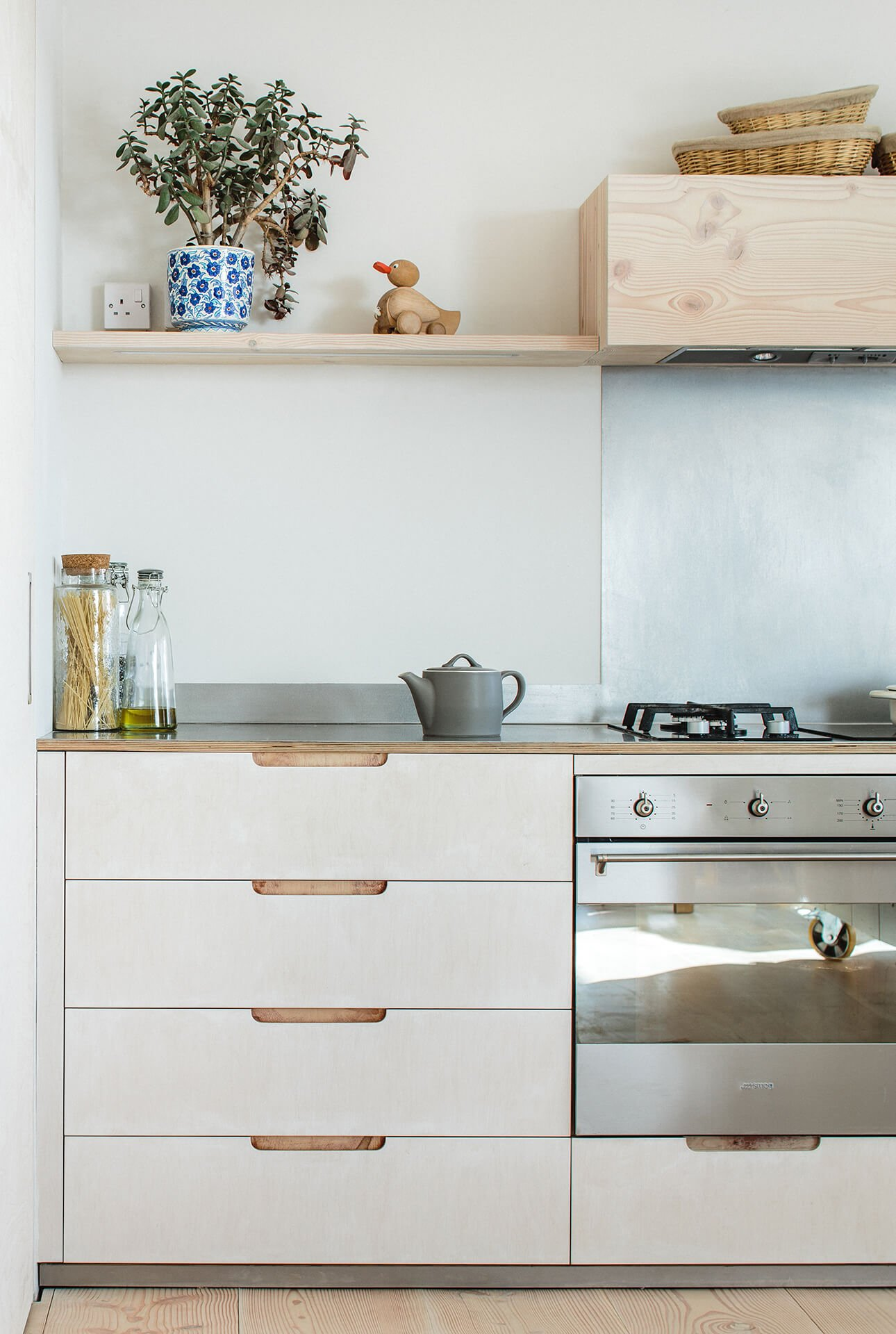Contemporary Eco Kitchen with lye treated drawers and Smeg oven