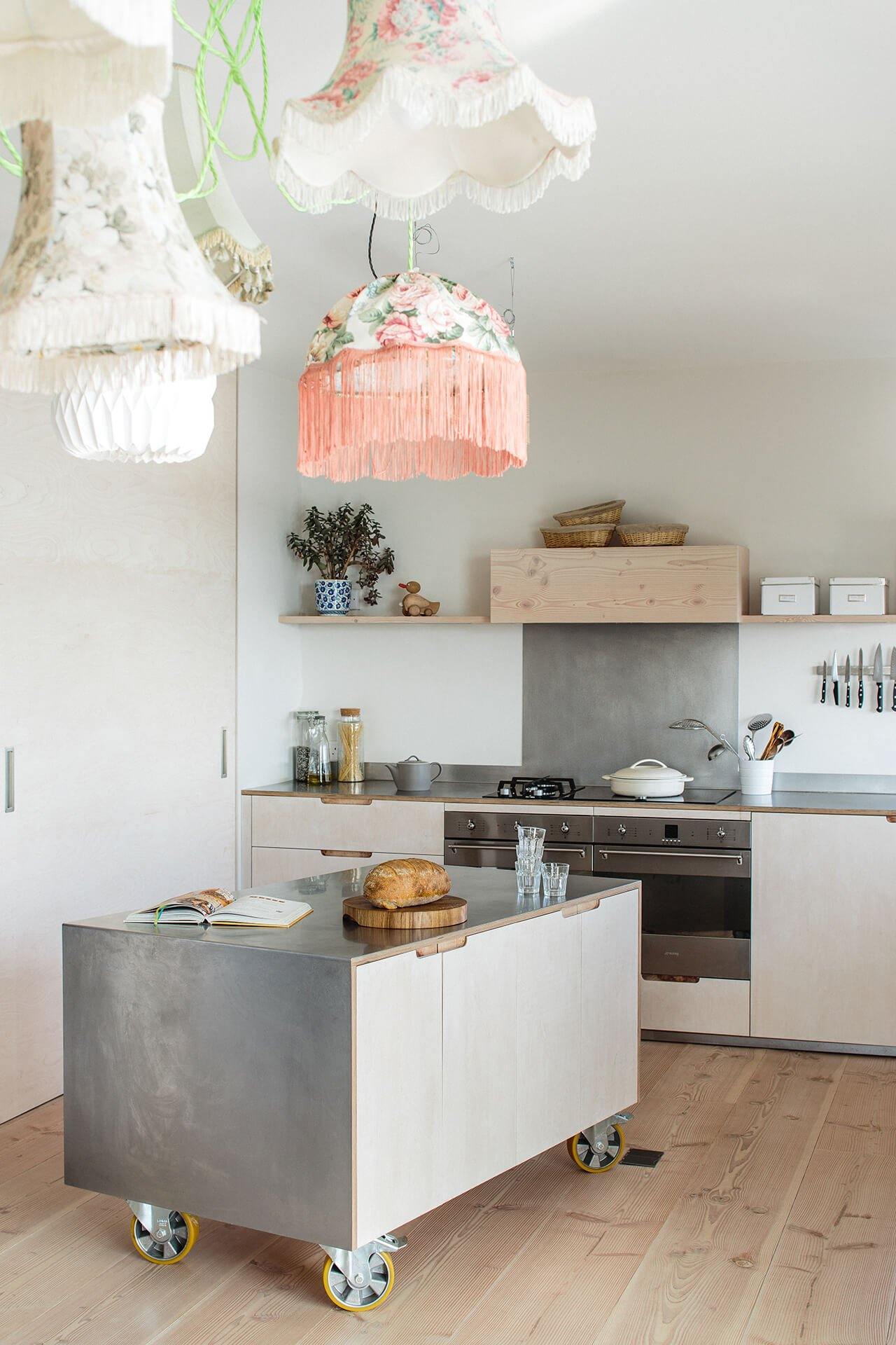 Contemporary Eco Kitchen with lye treated plywood cabinets and double Smeg ovens