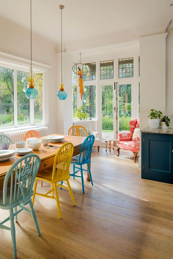 The Arts and Craft Kitchen with Large Farmhouse Table and Painted Chairs